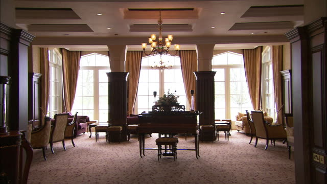 Traditional hotel lounge, old fashioned chairs and piano, Lough Erne, Northern Ireland