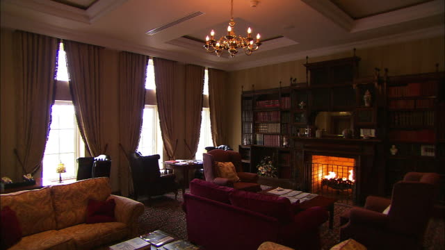 Traditional hotel lounge, old fashioned chairs and roaring fire, Lough Erne, Northern Ireland