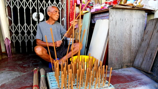 traditional incense making georgetown penang - sandalwood stock videos & royalty-free footage