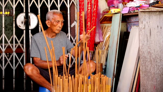 traditional incense making georgetown penang - penang stock videos and b-roll footage
