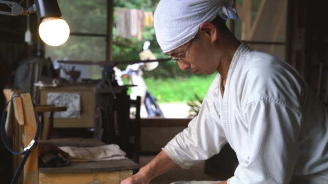 traditional japanese blacksmith grinding a blade - craftsperson stock videos and b-roll footage