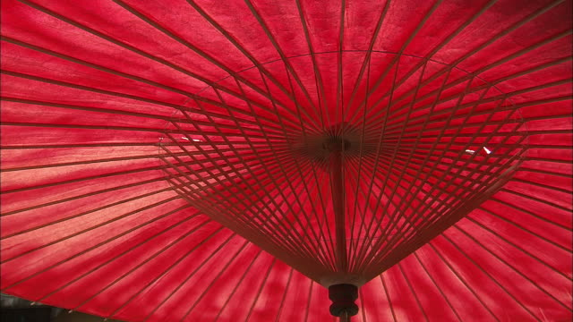 traditional japanese paper umbrella - roof tile stock videos & royalty-free footage