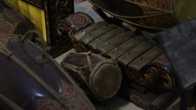 vídeos de stock e filmes b-roll de traditional javanese music instruments like kendang and gamelan which were used in a easter service during a worship in a catholic church in... - gamelão
