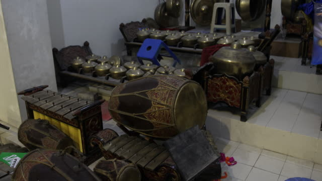 stockvideo's en b-roll-footage met traditional javanese music instruments like kendang and gamelan which were used in a easter service during a worship in a catholic church in... - missiehuis