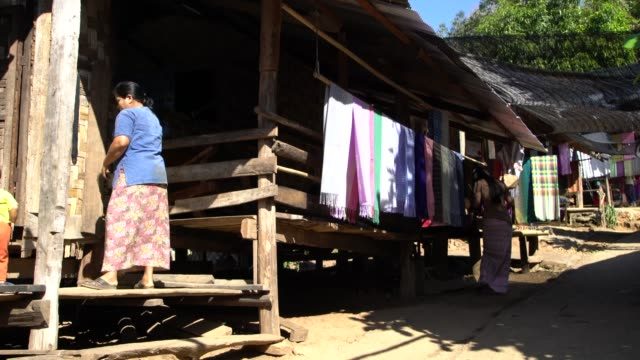 traditional karen tribe houses in the long neck village, northern thailand inhabited by karen tribe people - thailand stock videos & royalty-free footage