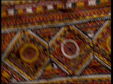 Traditional Kutch glass and thread embroidery.