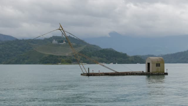traditional local fish boat of sun moon lake, taiwan - sun moon lake stock videos and b-roll footage