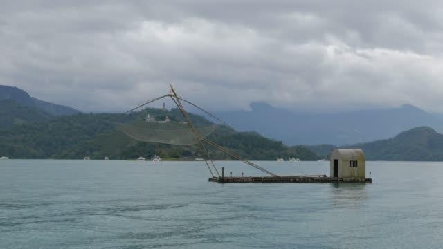 traditional local fishing of sun moon lake, taiwan - sun moon lake stock videos and b-roll footage