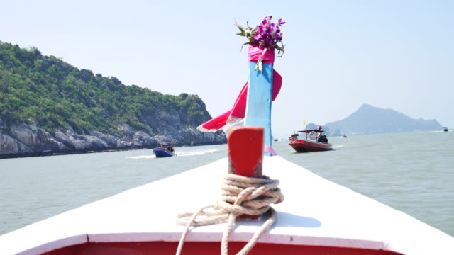 traditional long-tail boat tour. boat trip to islands in thailand. travel journey by water - longtail boat stock videos & royalty-free footage