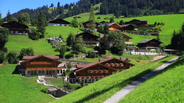 traditional luxury swiss chalets on august 7, 2020 in gstaad, switzerland. gstaad is known in high society circles for being a posh ski resort, a... - chalet stock videos & royalty-free footage