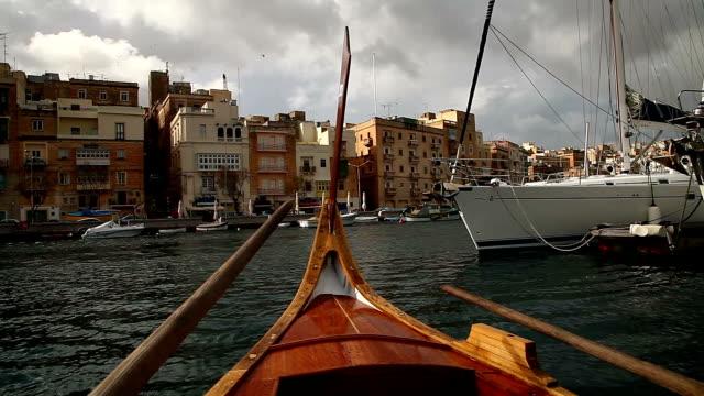 Traditional luzzu boats in Marsaxlokk