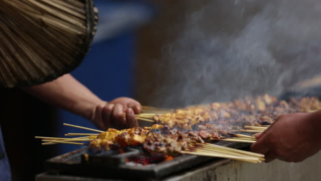 cu traditional malaysian satay being fanned and cooked - fan enthusiast stock videos & royalty-free footage