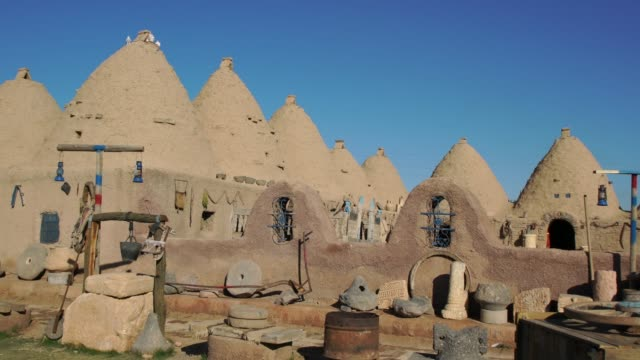 traditional mud brick buildings in harran, turkey, topped with domed roofs and constructed from mud and salvaged brick. - mud stock videos & royalty-free footage