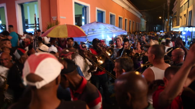 Traditional music of the 'San Salvador' side in the center of the village The crowd is surrounding the band and some dance General ambience in the...