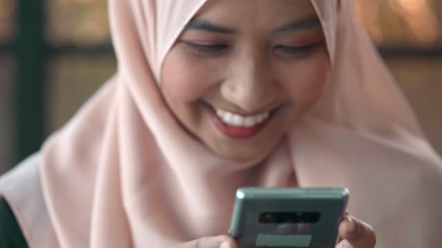 traditional muslim hijab on head typing phone - religious dress stock videos & royalty-free footage