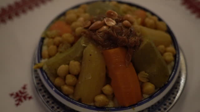 vídeos de stock, filmes e b-roll de traditional north african food - couscous in restaurant at medina quarter (old city) / tangier, morocco - tradição