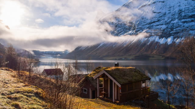 traditional norwegian houses with a view at a fjord - lake stock videos & royalty-free footage