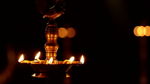 """cu traditional oil lamp burning / india "" - oil lamp stock videos & royalty-free footage"