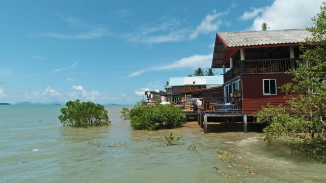 traditional over water stilt house bay, andaman sea, thailand - andaman sea stock videos & royalty-free footage