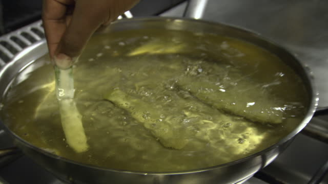 traditional peixinhos da horta or 'little fish from the garden', made of runner beans coated in batter, are deep fried, lisbon, portugal. - portuguese culture stock videos & royalty-free footage