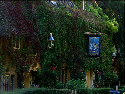 traditional pub covered in overgrown ivy cotswolds - cotswolds stock videos & royalty-free footage