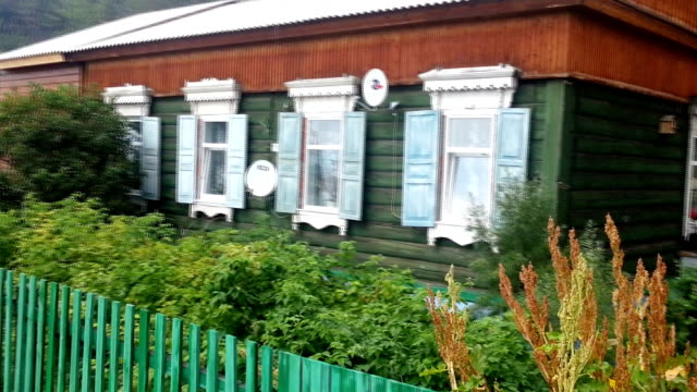 Traditional russian house,  stylized and filtered to resemble an oil painting