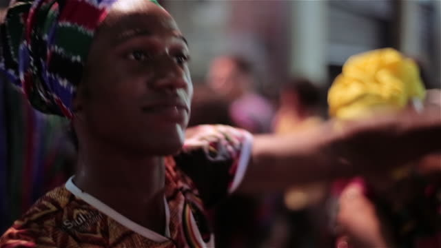 Traditional samba dancers move in sync to Brazilian drum music