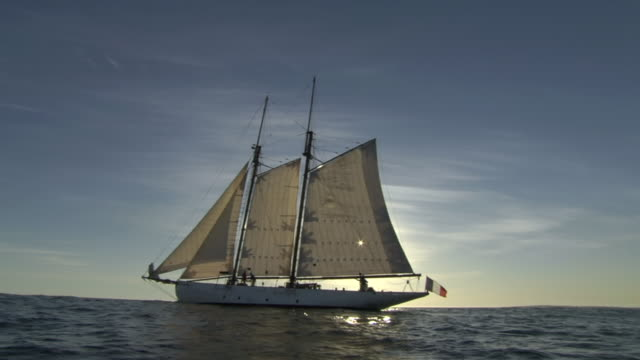 ms pov traditional schooner at sea with all sails full and sun behind sails / cape town, western cape, south africa - sailing ship stock videos & royalty-free footage