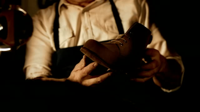 HD: Traditional Shoemaker Inspecting The Shoe