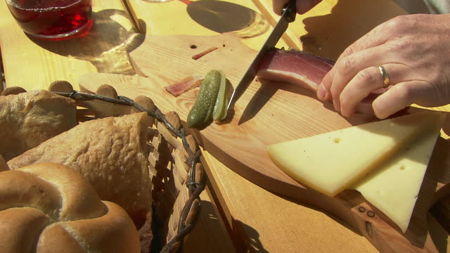 traditional snack in the mountains: bacon, cheese, and wine - trentino alto adige südtirol video stock e b–roll
