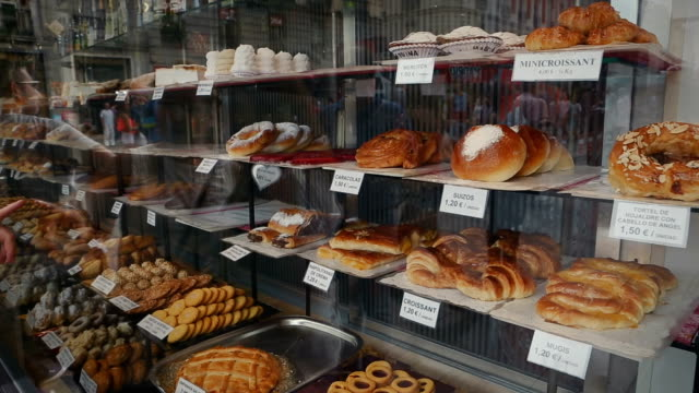 traditional spanish sweets and cakes in a shop - french food market stock videos & royalty-free footage