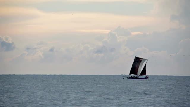 traditional sri lankan sailboat, negombo - sri lankan culture stock videos & royalty-free footage