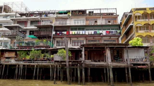traditional stilt houses, chinatown, chao phraya river, bangkok, thailand, asia - tradition stock videos & royalty-free footage