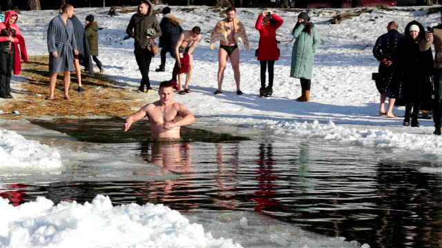 traditional swimming at epiphany frosts. - swimming stock videos & royalty-free footage