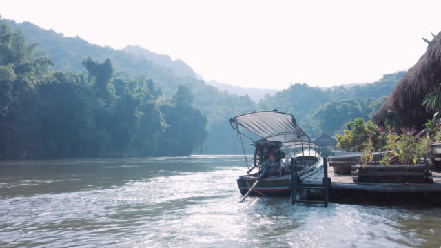 traditional thai long tail boat on river kwai in kanchanaburi - bamboo shoot stock videos & royalty-free footage