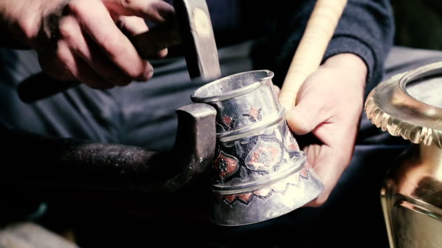 traditional tinsmith work. copper smith makes embossing artifacts from copper. designing utensils, the age old art of crafting wares. - only mature men stock videos & royalty-free footage