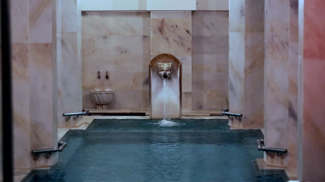 traditional turkish bath and pool with leon head - sauna stock videos & royalty-free footage