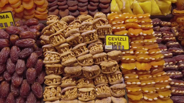 traditional turkish sweet food in an old bazaar in istanbul, turkey - grand bazaar istanbul stock videos and b-roll footage