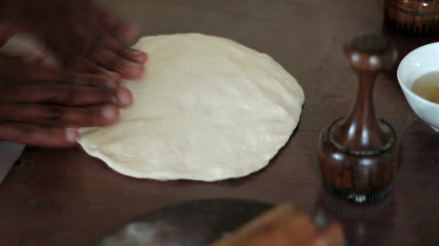 traditional way for making flat bread - tortilla flatbread stock videos & royalty-free footage