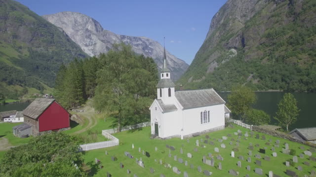traditional white church in the village of nærøy along nærøyfjord, gudvangen, unesco world heritage site, aurland, norway - unesco world heritage site stock videos & royalty-free footage