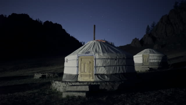 vídeos de stock e filmes b-roll de traditional white gers on land at night - ulaanbaatar, mongolia - ulan bator