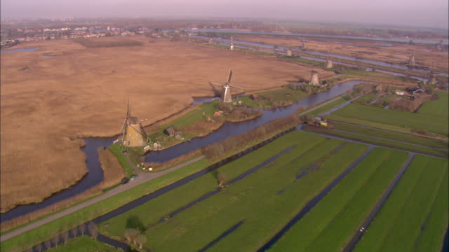 aerial, traditional wind mils in farmland, netherlands - オランダ文化点の映像素材/bロール