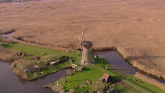 aerial, traditional wind mils in farmland, netherlands - dutch culture stock videos & royalty-free footage