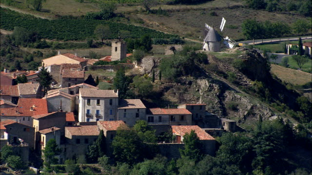 traditional windmill  - aerial view - languedoc-roussillon, aude, arrondissement de narbonne, france - aude stock videos & royalty-free footage