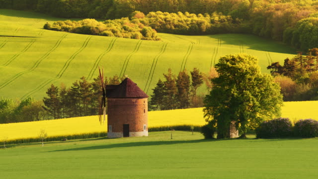 ls traditional windmill and a chapel in the countryside of moravia - traditionally czech stock videos & royalty-free footage