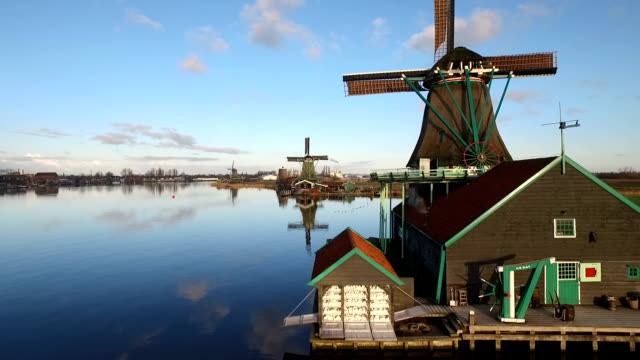 Traditional windmills and water canal in Holland, Netherlands