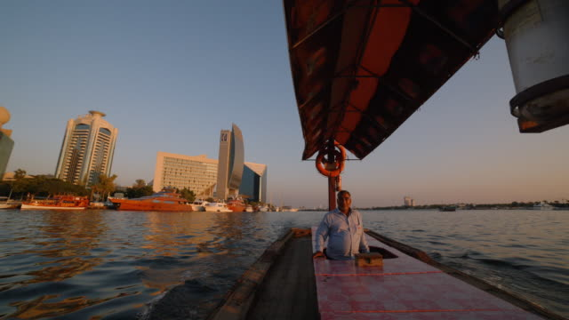 pov- traditional wooden dhow boat at sunset - dubai - history stock videos & royalty-free footage