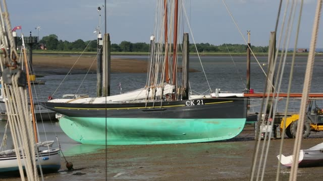 a traditional wooden sailing boat at brightlingsea, essex, uk. - estuary stock videos & royalty-free footage