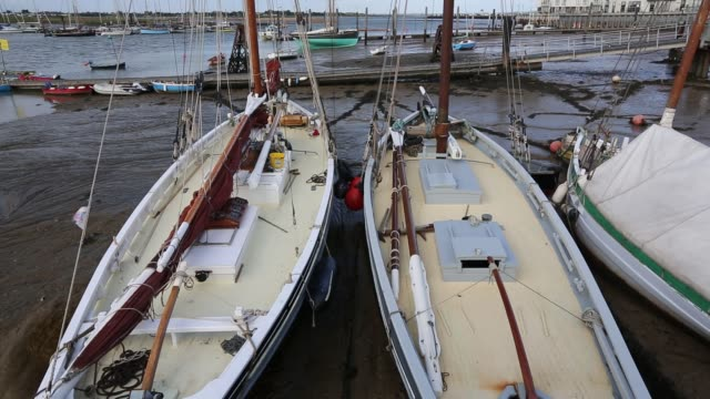 traditional wooden smack fishing boats beached in brightlingsea, essex, united kingdom on september 3, 2015. - wood material stock videos & royalty-free footage