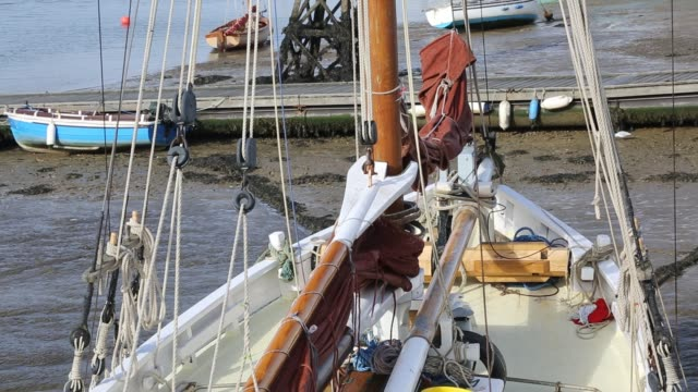 a traditional wooden smack fishing boats beached in brightlingsea essex united kingdom on september 3 2015 - sailing boat stock videos & royalty-free footage